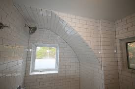 sagging tin ceiling tiles bathroom: salt point bathroom renovation c a c b  new dimension construction curved ceiling with subway