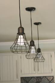 wow budget kitchen remodel by designer trapped in a lawyers body totally transformed with cage pendant lighting