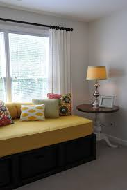 i do have a twin bed in my office i am thinking seriously about building a daybed with baskets like this one in the photo a great idea for creating more bed in office