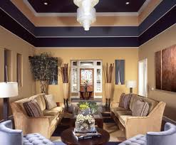furniture living room wall: living room in beige located just off the front foyer of this luxury home