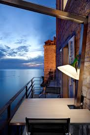 incredible ocean view seen from tower in rovinj house balcony furnished with a set of dining furniture balcony furnished small