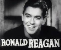 "A Carreira cinematográfica de Ronald Reagan se desenrolou até meados dos anos 1960 – quando participou da película ""Os Assassinos"" (1964). - Ronald_Reagan_in_Cowboy_From_Brooklyn_trailer"
