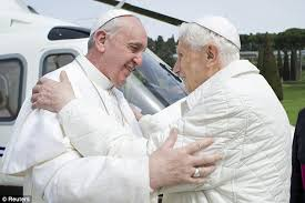 Pope Benedict  right  was seen as quite a conservative pontiff while Pope Francis