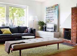 small apartment living room design ideas with black leather sofa cushion and throw pillows also laminate apartment living room furniture
