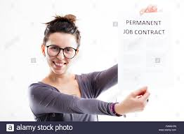 happy w on glasses holding her permanent job contract stock stock photo happy w on glasses holding her permanent job contract