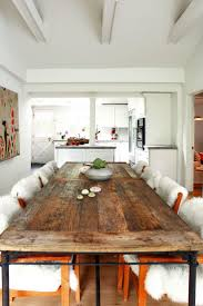 long wood dining table: this all white dining room features a reclaimed wood dining table and easy access to