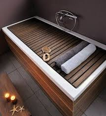 bathroom space savers bathtub storage: bathtub cover to use as a bench bathtub storagespace saving bathroomdesign
