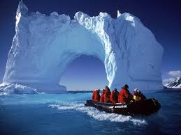 People boating through a glacier