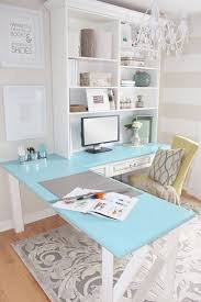 home office 3 this one is heaven loving the wood floors chic textured rug and brass accented desk brass is coming back people chic home office design
