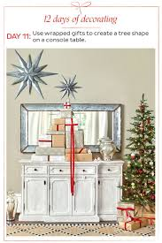 decorations create holiday todays holiday decorating tip is to stack wrapped gifts on a console t