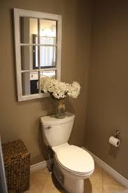 half bath decor: old window mirror this is a great idea if you have a windowless bathroom adds depth and the light will bounce off it making the room seem larger and