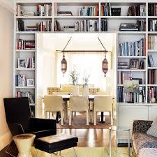 storage solutions living room: frame a doorway bookshelves around entry  frame a doorway