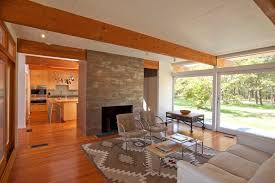 lighting for exposed beams living room midcentury with stone fireplace surround exposed beams beams lighting