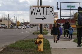 flint water crisis a visual essay water water everywhere people walk along saginaw street on flint s north side past a sign for water being given away at mt calvary missionary baptist church in flint