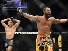Johny Hendricks putting his arms up in belief of his victory