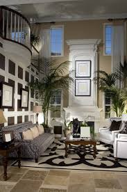 curtains for formal living room  story great room with white fireplace mezzanine looking down on living room large