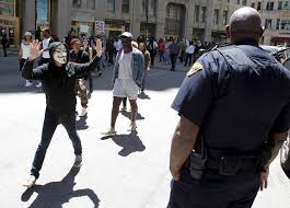 cleveland justice department reach settlement over police a protester his hands up walks by a cleveland police officer following a not guilty
