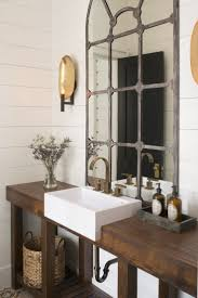beautiful rustic industrial bathroom design that mirror is incredible looking on the plank wood wall arteriors soho industrial style pendant light fixture