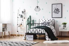 <b>Toy</b> In <b>Shape</b> Of <b>Cactus</b> Next To <b>Bed</b> With Black Blanket And Grey ...