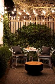 small patio ideas outdoor string lights cast a lovely glow on a small patio at balcony lighting ideas