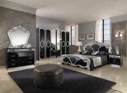 image of appealing black mirrored bedroom set with white acrylic table lamp and double arm wall acrylic bedroom furniture