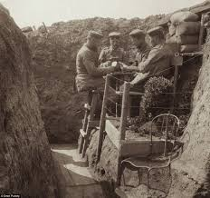 world war one from a german ier s perspective hundreds of pictures such as this one of german iers playing cards together next to their trenches