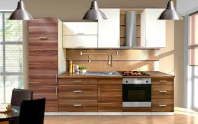 kitchen modern cabinets designs: astounding modern wooden kitchen cabinet design with electric range combined with oven completed with sink and solid surface countertop also with rough