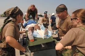 u s department of > photos > photo gallery crews carry hurricane katrina victims who were airlifted into new orleans international airport in new orleans