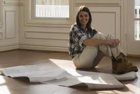 Where Are the Floor Plans for This Old House Long haired smiling w  in checked workshirt sitting in empty room   blueprints on the