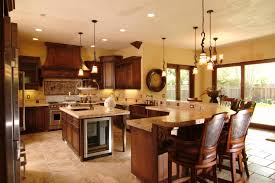 shaped kitchen island stove top in this kitchen defined by wraparound counter space modest sized islan