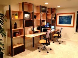 cool home office design with brown wall mounted desk and square brown shelving units complete with modern black swivel chairs designed with orange seat pad unique design home office desk full