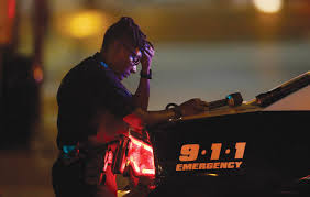 black lives and the police by darryl pinckney the new york a police officer in downtown dallas after the shootings that killed five of her fellow officers