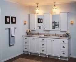 catchy white bathroom focused on minimalist vanity set with twin wall mirrors plus dim pendant lighting bathroom pendant lighting ideas beige granite