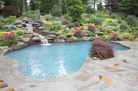Small Picture This pool garden echos the colours of the paving Could work with
