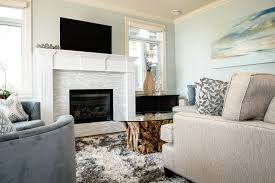 glass tile fireplace living room beach with beige sectional beige sofa image by the spotted frog designs beige sectional living room