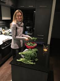 brodie lawson strong smart and bringin it to the cfl and grey cup at home in toronto laughing while prepping giant kale that she had just purchased from toronto s st lawrence market