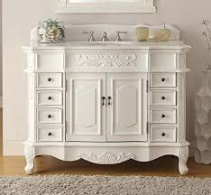 traditional style antique white bathroom: the antique white morton bathroom vanity has classic traditional style with carved decorative scrolling leaf design and carved tu