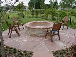 outdoor fireplace paver patio: backyard  accesories decors exterior landscape backyard covered patio pictures lounge space rounded fire pit also seating on stones paver outdoor patio flooring ideas