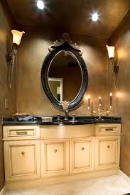 bathroom place vanity contemporary: small  interior oval black wooden bathroom mirror with brown carving accent on the top connected by soft brown wooden bathroom vanity on the floor awesome oval bathroom mirrors offer remarkable look placed i