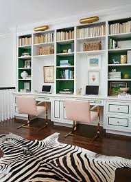 stunning home office features a wall of built in bookcases with backs of bookcases chic home office features