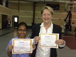 investwrite grade 4 and 5 winner sneha mokkala and teacher ms janie dostal from the
