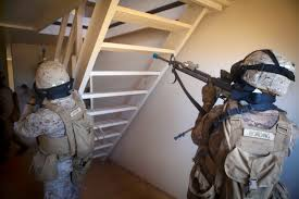u s department of defense photo essay marines provide security on a stairwell during a raid on a simulated compound at the boondocker