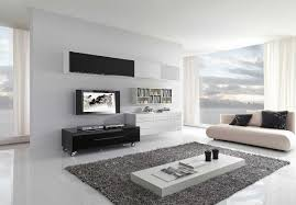 amusing white living room color ideas with cream sofa and white table on gray rug furnished with floating bookshelf beside flatscreen tv also beautiful amusing white room