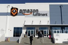 amazon set to hire 120 000 seasonal workers for the holidays jobs employees arrive at amazon s san bernardino fulfillment center 29 2013 credit