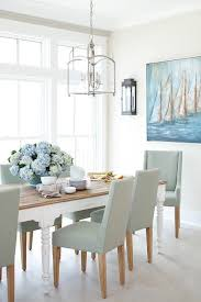 Large dining room windows invite <b>lots of</b> light <b>shining</b> on a white ...