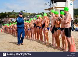 wearing caps their classification numbers teen applicants stock photo wearing caps their classification numbers teen applicants for lifeguard jobs wait to start long distance qualifying swim