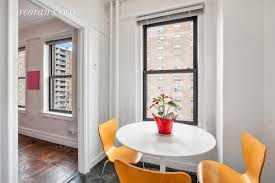 corner unit comes with views of the empire state building high beamed ceilings hardwood floors an oversized living room and an eat in kitchen anatomy eat kitchen