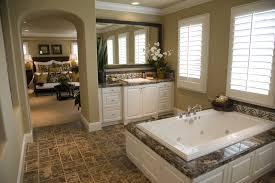 ideas bathroom tile color cream neutral: teal glass tile bathroom traditional with arched doorway decorative backsplash