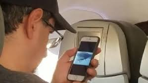 Man watches 9/11 footage on phone during flight | Video