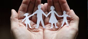 cut out family held in the palm of the hand
